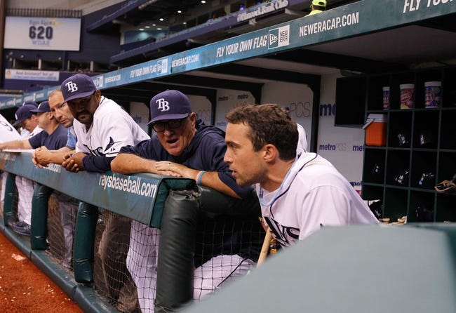 Aug 15, 2013; St. Petersburg, FL, USA; Tampa Bay Rays manager Joe Maddon (70) talks with left fielder Sam Fuld (5) during the fifth inning against the Seattle Mariners at Tropicana Field. Mandatory Credit: Kim Klement-USA TODAY Sports