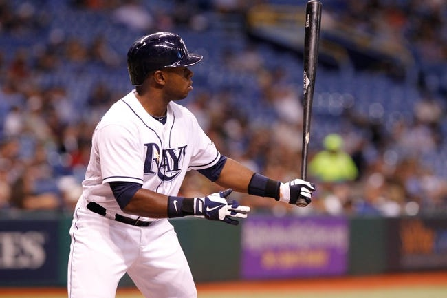Aug 15, 2013; St. Petersburg, FL, USA; Tampa Bay Rays left fielder Jason Bourgeois (13) at bat during the fifth inning against the Seattle Mariners at Tropicana Field. Mandatory Credit: Kim Klement-USA TODAY Sports