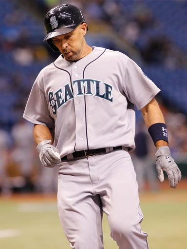 Aug 15, 2013; St. Petersburg, FL, USA; Seattle Mariners left fielder Raul Ibanez (28) scores a run after he hit a solo home run against the Tampa Bay Rays at Tropicana Field. Mandatory Credit: Kim Klement-USA TODAY Sports