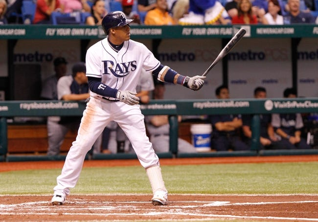 Aug 15, 2013; St. Petersburg, FL, USA; Tampa Bay Rays shortstop Yunel Escobar (11) at bat against the Seattle Mariners at Tropicana Field. Mandatory Credit: Kim Klement-USA TODAY Sports
