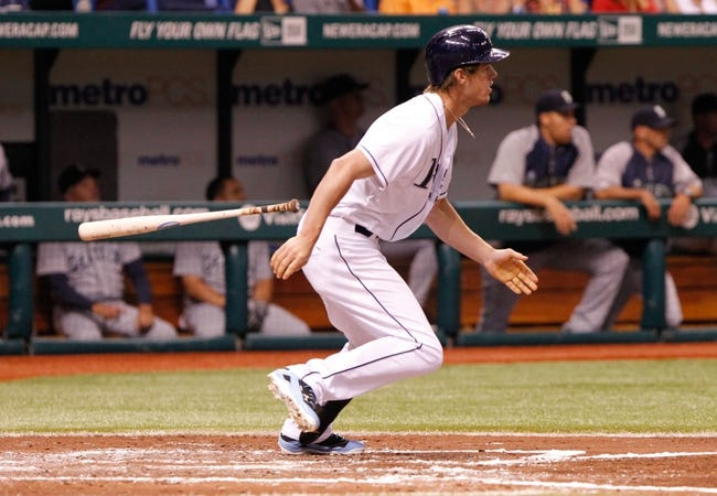 Aug 15, 2013; St. Petersburg, FL, USA; Tampa Bay Rays right fielder Wil Myers (9) hits a RBI single during the third inning against the Seattle Mariners at Tropicana Field. Mandatory Credit: Kim Klement-USA TODAY Sports