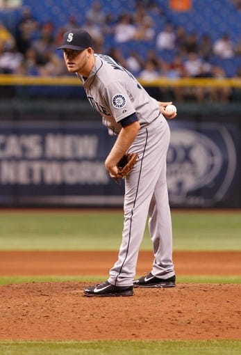 Aug 15, 2013; St. Petersburg, FL, USA; Seattle Mariners starting pitcher Brandon Maurer (37) throws a pitch during the fifth inning against the Tampa Bay Rays at Tropicana Field. Mandatory Credit: Kim Klement-USA TODAY Sports
