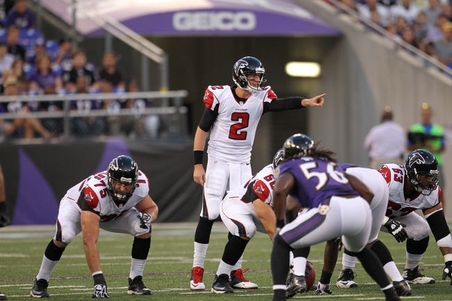 Aug 15, 2013; Baltimore, MD, USA; Atlanta Falcons quarterback Matt Ryan (2) directs the offense against the Baltimore Ravens at M&T Bank Stadium. Mandatory Credit: Mitch Stringer-USA TODAY Sports