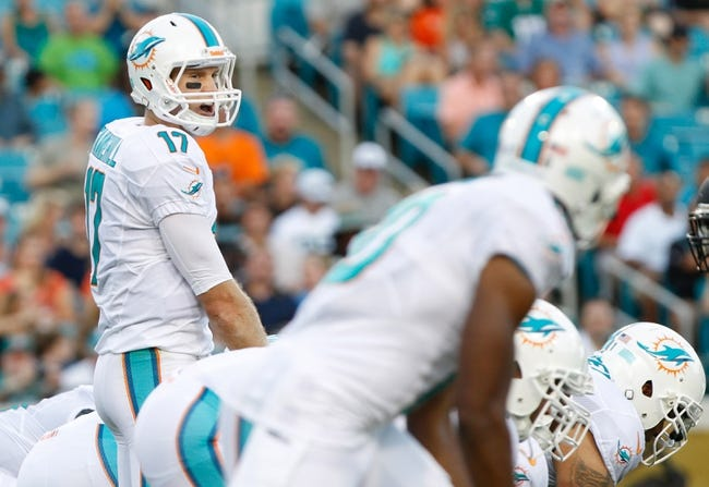 Aug 9, 2013; Jacksonville, FL, USA; Miami Dolphins quarterback Ryan Tannehill (17) calls a play during the first quarter against the Jacksonville Jaguars at EverBank Field. Mandatory Credit: Kim Klement-USA TODAY Sports