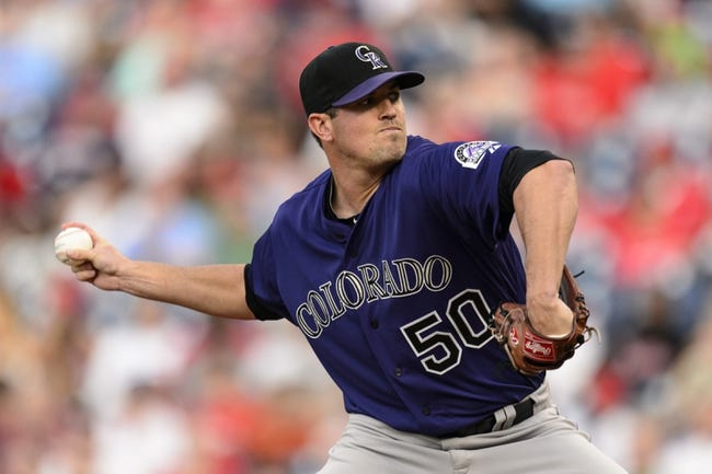 Aug 19, 2013; Philadelphia, PA, USA; Colorado Rockies pitcher Jeff Manship (50) delivers to the plate during the first inning against the Philadelphia Phillies at Citizens Bank Park. Mandatory Credit: Howard Smith-USA TODAY Sports