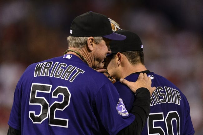 Aug 19, 2013; Philadelphia, PA, USA; Colorado Rockies pitching coach Jim Wright talks with pitcher Jeff Manship (50) during the fourth inning against the Philadelphia Phillies at Citizens Bank Park. Mandatory Credit: Howard Smith-USA TODAY Sports