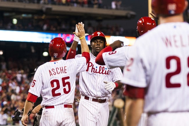 Aug 19, 2013; Philadelphia, PA, USA; Philadelphia Phillies center fielder John Mayberry (15) celebrates hitting a three run home run during the fourth inning against the Colorado Rockies at Citizens Bank Park. Mandatory Credit: Howard Smith-USA TODAY Sports