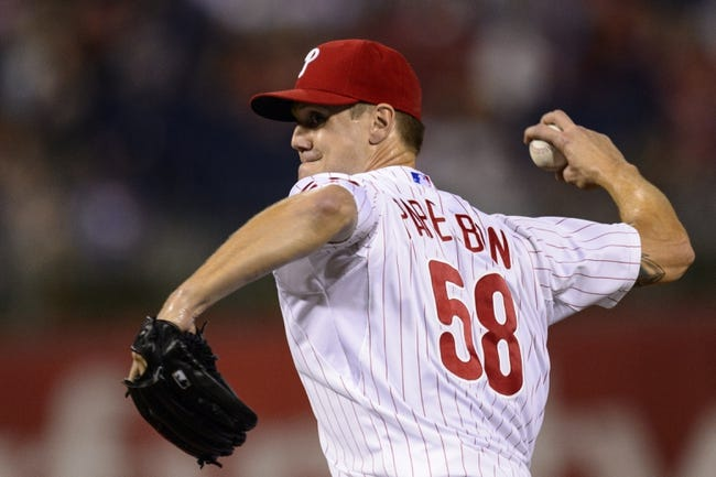 Aug 19, 2013; Philadelphia, PA, USA; Philadelphia Phillies pitcher Jonathan Papelbon (58) delivers to the plate during the ninth inning against the Colorado Rockies at Citizens Bank Park. The Phillies defeated the Rockies 5-4. Mandatory Credit: Howard Smith-USA TODAY Sports