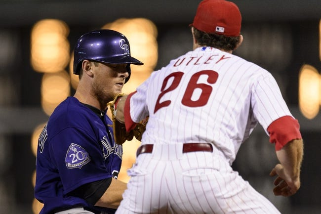Aug 19, 2013; Philadelphia, PA, USA; Philadelphia Phillies second baseman Chase Utley (26) tags out Colorado Rockies second baseman DJ LeMahieu (9) after being caught in a rundown during the ninth inning at Citizens Bank Park. The Phillies defeated the Rockies 5-4. Mandatory Credit: Howard Smith-USA TODAY Sports