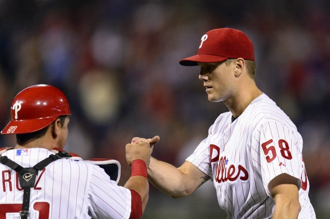 Aug 19, 2013; Philadelphia, PA, USA; Philadelphia Phillies pitcher Jonathan Papelbon (58) celebrates with catcher Carlos Ruiz (51) after pitching the ninth inning against the Colorado Rockies at Citizens Bank Park. The Phillies defeated the Rockies 5-4. Mandatory Credit: Howard Smith-USA TODAY Sports