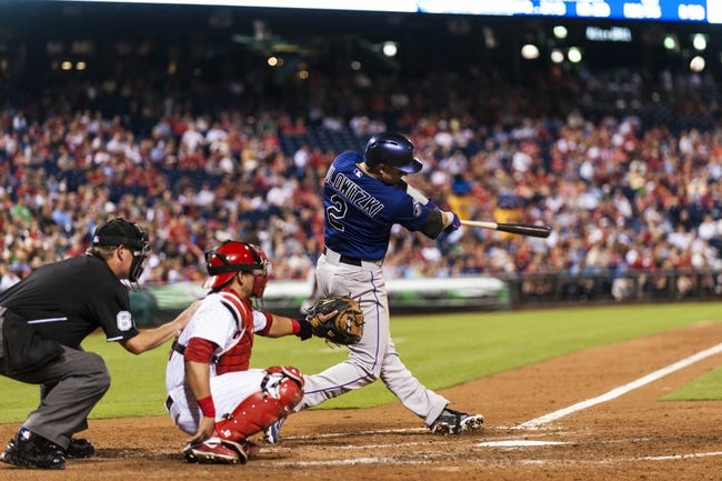 Aug 19, 2013; Philadelphia, PA, USA; Colorado Rockies left fielder Troy Tulowitzki (2) hits a home run during the seventh inning against the Philadelphia Phillies at Citizens Bank Park. The Phillies defeated the Rockies 5-4. Mandatory Credit: Howard Smith-USA TODAY Sports
