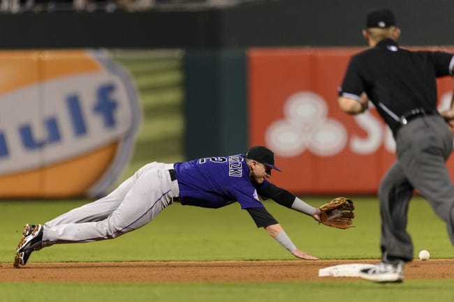 Aug 19, 2013; Philadelphia, PA, USA; Colorado Rockies left fielder Troy Tulowitzki (2) is unable to make the play on the ball during the fourth inning against the Philadelphia Phillies at Citizens Bank Park. The Phillies defeated the Rockies 5-4. Mandatory Credit: Howard Smith-USA TODAY Sports