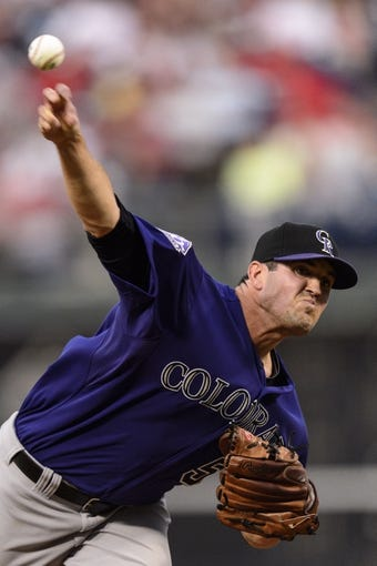 Aug 19, 2013; Philadelphia, PA, USA; Colorado Rockies pitcher Jeff Manship (50) delivers to the plate during the second inning against the Philadelphia Phillies at Citizens Bank Park. The Phillies defeated the Rockies 5-4. Mandatory Credit: Howard Smith-USA TODAY Sports