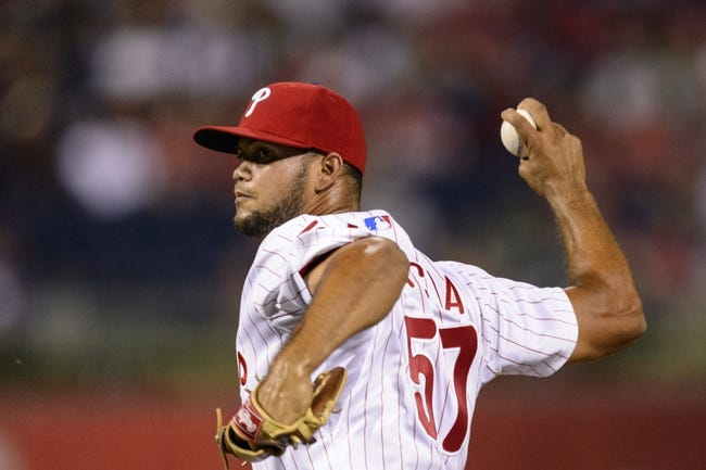Aug 19, 2013; Philadelphia, PA, USA; Philadelphia Phillies pitcher Luis Garcis (57) delivers to the plate during the eighth inning against the Colorado Rockies at Citizens Bank Park. The Phillies defeated the Rockies 5-4. Mandatory Credit: Howard Smith-USA TODAY Sports