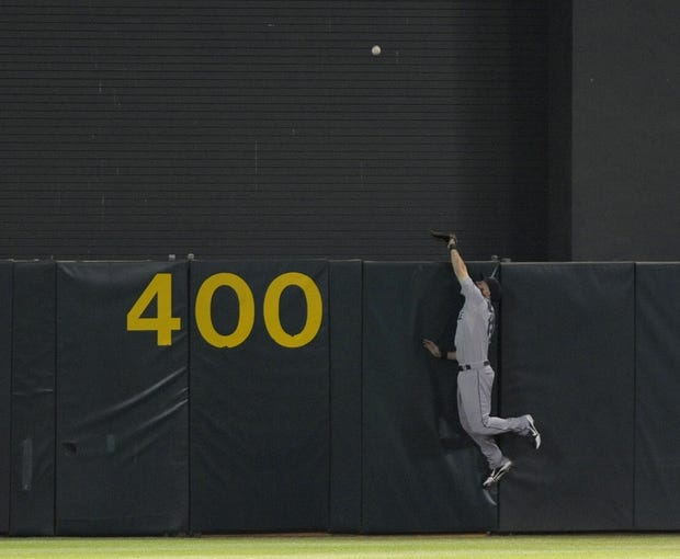 Aug 19, 2013; Oakland, CA, USA; Seattle Mariners second baseman Dustin Ackley (13) attempts to make the catch in center field during the ninth inning of the game against the Oakland Athletics at O.Co Coliseum. The Oakland Athletics defeated the Seattle Mariners 2-1. Mandatory Credit: Ed Szczepanski-USA TODAY Sports