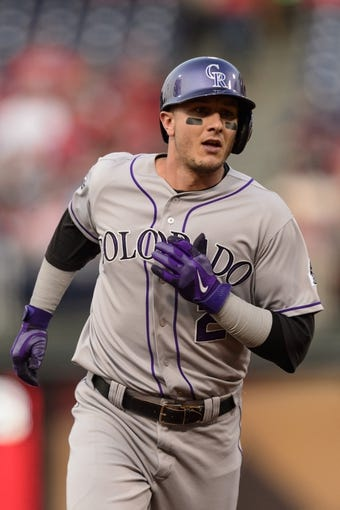 Aug 20, 2013; Philadelphia, PA, USA; Colorado Rockies left fielder Troy Tulowitzki (2) rounds the bases after hitting a two run home run during the first inning against the Philadelphia Phillies at Citizens Bank Park. Mandatory Credit: Howard Smith-USA TODAY Sports