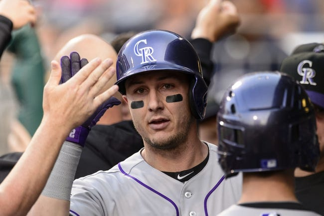 Aug 20, 2013; Philadelphia, PA, USA; Colorado Rockies left fielder Troy Tulowitzki (2) celebrates hitting a two run home run during the first inning against the Philadelphia Phillies at Citizens Bank Park. Mandatory Credit: Howard Smith-USA TODAY Sports