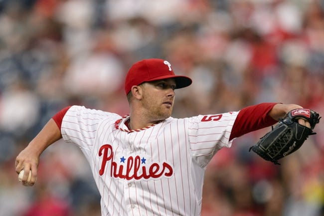 Aug 20, 2013; Philadelphia, PA, USA; Philadelphia Phillies pitcher Tyler Cloyd (50) delivers to the plate during the first inning against the Colorado Rockies at Citizens Bank Park. Mandatory Credit: Howard Smith-USA TODAY Sports