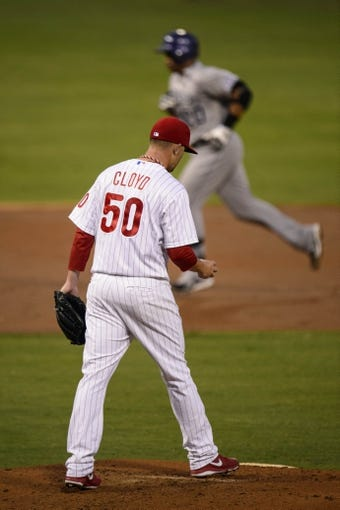 Aug 20, 2013; Philadelphia, PA, USA; Philadelphia Phillies pitcher Tyler Cloyd (50) walks back up the mound after giving up a home run to Colorado Rockies catcher Wilin Rosario (20) during the third inningat Citizens Bank Park. Mandatory Credit: Howard Smith-USA TODAY Sports