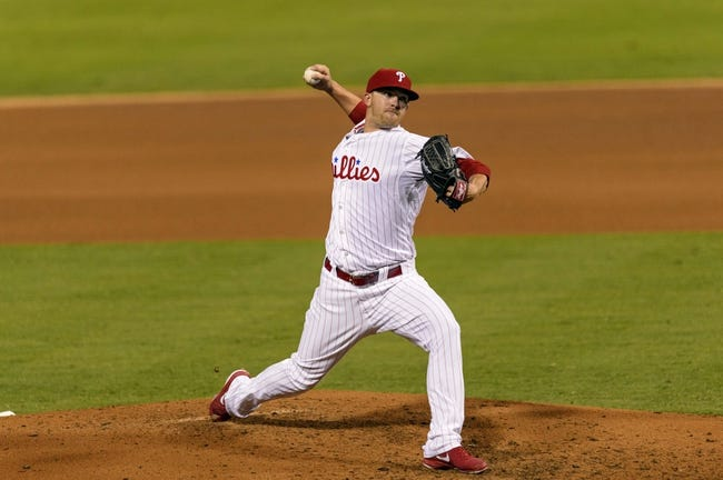 Aug 20, 2013; Philadelphia, PA, USA; Philadelphia Phillies pitcher Tyler Cloyd (50) delivers to the plate during the fourth inning against the Colorado Rockies at Citizens Bank Park. Mandatory Credit: Howard Smith-USA TODAY Sports