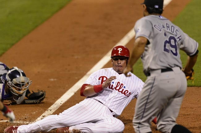 Aug 20, 2013; Philadelphia, PA, USA; Philadelphia Phillies catcher Carlos Ruiz (51) scores during the third inning against the Colorado Rockies at Citizens Bank Park. Mandatory Credit: Howard Smith-USA TODAY Sports