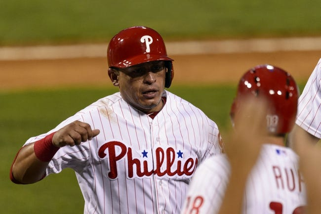 Aug 20, 2013; Philadelphia, PA, USA; Philadelphia Phillies catcher Carlos Ruiz (51) celebrates scoring with right fielder Darin Ruf (18) during the third inning against the Colorado Rockies at Citizens Bank Park. Mandatory Credit: Howard Smith-USA TODAY Sports