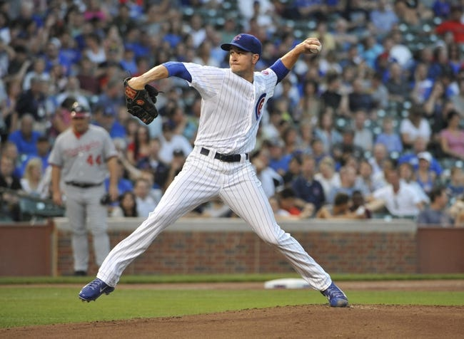 Aug 20, 2013; Chicago, IL, USA; Chicago Cubs starting pitcher Chris Rusin (18) pitches against the Washington Nationals during the first inning at Wrigley Field. Mandatory Credit: David Banks-USA TODAY Sports