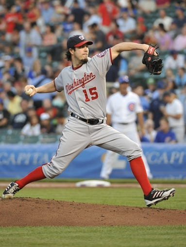 Aug 20, 2013; Chicago, IL, USA; Washington Nationals starting pitcher Dan Haren (15) pitches against the Chicago Cubs during the first inning at Wrigley Field. Mandatory Credit: David Banks-USA TODAY Sports