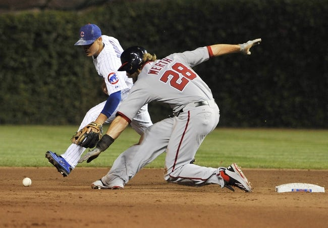 Aug 20, 2013; Chicago, IL, USA; Washington Nationals right fielder Jayson Werth (28) over runs second base as Chicago Cubs second baseman Darwin Barney (15) gets the ball to tag him out during the sixth inning at Wrigley Field. Mandatory Credit: David Banks-USA TODAY Sports