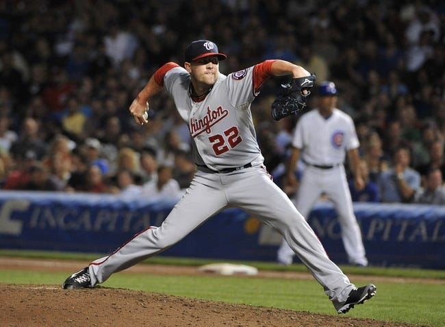 Aug 20, 2013; Chicago, IL, USA; Washington Nationals relief pitcher Drew Storen (22) pitches against the Chicago Cubs during the seventh inning at Wrigley Field. Mandatory Credit: David Banks-USA TODAY Sports