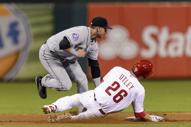 Aug 20, 2013; Philadelphia, PA, USA; Colorado Rockies shortstop Troy Tulowitzki (2) tags out Philadelphia Phillies second baseman Chase Utley (26) at second base during the eighth inning at Citizens Bank Park. The Rockies defeated the Phillies 5-3. Mandatory Credit: Howard Smith-USA TODAY Sports