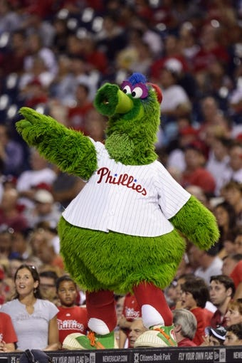 Aug 20, 2013; Philadelphia, PA, USA; The Philadelphia Phillies mascot the Phillie Phanatic entertains the fans during the seventh inning against the Colorado Rockies at Citizens Bank Park. The Rockies defeated the Phillies 5-3. Mandatory Credit: Howard Smith-USA TODAY Sports