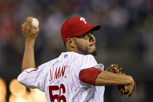Aug 20, 2013; Philadelphia, PA, USA; Philadelphia Phillies pitcher Cesar Jimenez (56) delivers to the plate during the eighth inning against the Colorado Rockies at Citizens Bank Park. The Rockies defeated the Phillies 5-3. Mandatory Credit: Howard Smith-USA TODAY Sports