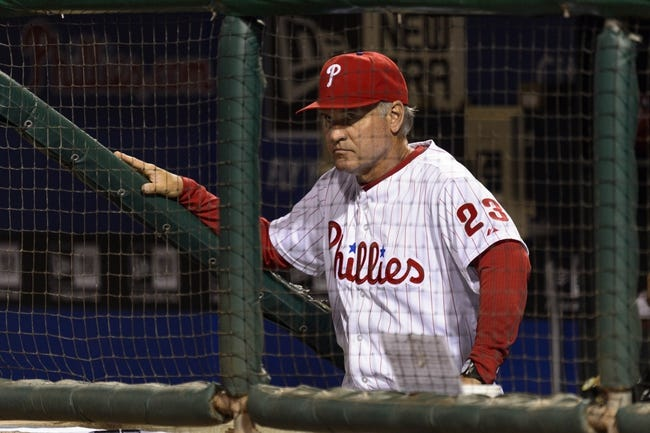 Aug 20, 2013; Philadelphia, PA, USA; Philadelphia Phillies interim manager Ryne Sandberg (23) in the dugout during the seventh inning against the Colorado Rockies at Citizens Bank Park. The Rockies defeated the Phillies 5-3. Mandatory Credit: Howard Smith-USA TODAY Sports