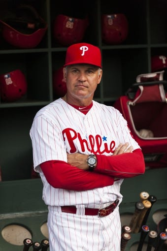 Aug 20, 2013; Philadelphia, PA, USA; Philadelphia Phillies interim manager Ryne Sandberg (23) in the dugout prior to playing the Colorado Rockies at Citizens Bank Park. The Rockies defeated the Phillies 5-3. Mandatory Credit: Howard Smith-USA TODAY Sports