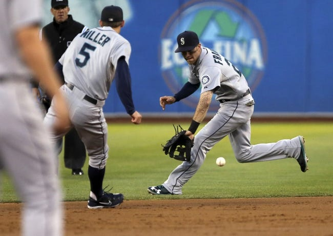 Aug 20, 2013; Oakland, CA, USA; Seattle Mariners second baseman Nick Franklin (20) gathers the ball with shortstop Brad Miller (5) against the Oakland Athletics during the second inning at O.co Coliseum. Mandatory Credit: Kelley L Cox-USA TODAY Sports