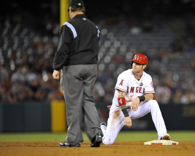 August 20, 2013; Anaheim, CA, USA; Los Angeles Angels right fielder Josh Hamilton (32) reacts after being tagged out at second in the eighth inning against the Cleveland Indians at Angel Stadium of Anaheim. Mandatory Credit: Gary A. Vasquez-USA TODAY Sports