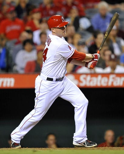 August 20, 2013; Anaheim, CA, USA; Los Angeles Angels first baseman Mark Trumbo (44) hits  a single in the eighth inning against the Cleveland Indians at Angel Stadium of Anaheim. Mandatory Credit: Gary A. Vasquez-USA TODAY Sports