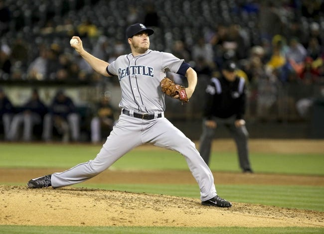 Aug 20, 2013; Oakland, CA, USA; Seattle Mariners relief pitcher Brandon Maurer (37) pitches the ball against the Oakland Athletics during the seventh inning at O.co Coliseum. Mandatory Credit: Kelley L Cox-USA TODAY Sports