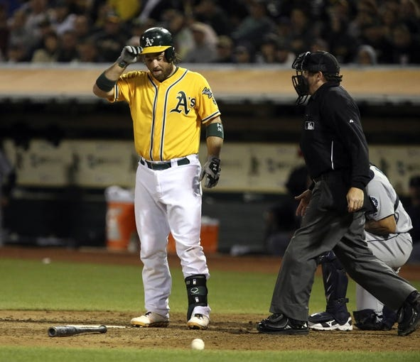 Aug 20, 2013; Oakland, CA, USA; Oakland Athletics catcher Derek Norris (36) reacts after being hit by the pitch against the Seattle Mariners during the seventh inning at O.co Coliseum. Mandatory Credit: Kelley L Cox-USA TODAY Sports