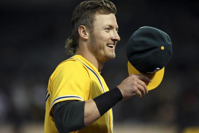 Aug 20, 2013; Oakland, CA, USA; Oakland Athletics third baseman Josh Donaldson (20) smiles after the seventh inning against the Seattle Mariners at O.co Coliseum. Mandatory Credit: Kelley L Cox-USA TODAY Sports