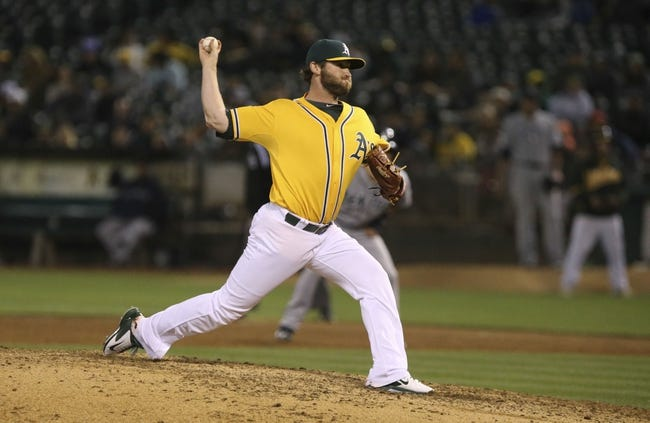 Aug 20, 2013; Oakland, CA, USA; Oakland Athletics relief pitcher Ryan Cook (48) pitches the ball against the Seattle Mariners during the eighth inning at O.co Coliseum. The Seattle Mariners defeated the Oakland Athletics 7-4. Mandatory Credit: Kelley L Cox-USA TODAY Sports