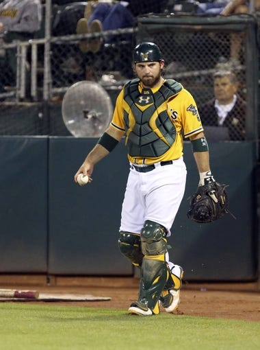 Aug 20, 2013; Oakland, CA, USA; Oakland Athletics catcher Derek Norris (36) gathers the ball after a wild pitch allows a run by the Seattle Mariners during the eighth inning at O.co Coliseum. The Seattle Mariners defeated the Oakland Athletics 7-4. Mandatory Credit: Kelley L Cox-USA TODAY Sports