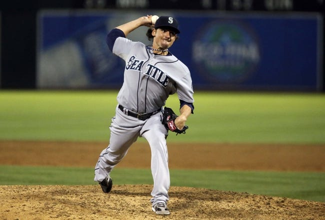 Aug 20, 2013; Oakland, CA, USA; Seattle Mariners relief pitcher Danny Farquhar (40) pitches the ball against the Oakland Athletics during the ninth inning at O.co Coliseum. The Seattle Mariners defeated the Oakland Athletics 7-4. Mandatory Credit: Kelley L Cox-USA TODAY Sports