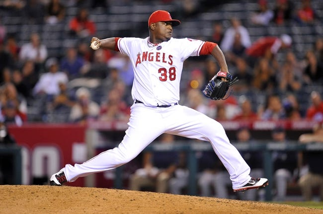August 20, 2013; Anaheim, CA, USA; Los Angeles Angels relief pitcher J.C. Gutierrez (38) pitches in the tenth inning against the Cleveland Indians at Angel Stadium of Anaheim. Mandatory Credit: Gary A. Vasquez-USA TODAY Sports