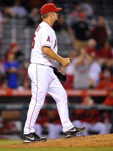 August 20, 2013; Anaheim, CA, USA; Los Angeles Angels starting pitcher Joe Blanton (55) reacts after giving up a two run home run in the fourteenth inning against the Cleveland Indians at Angel Stadium of Anaheim. Mandatory Credit: Gary A. Vasquez-USA TODAY Sports