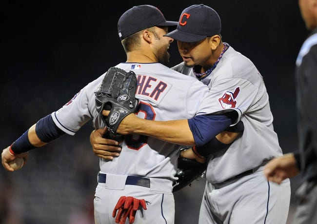 August 20, 2013; Anaheim, CA, USA; Cleveland Indians first baseman Nick Swisher (33) and starting pitcher Carlos Carrasco (59) celebrate the 4-1 victory against the Los Angeles Angels at Angel Stadium of Anaheim. Mandatory Credit: Gary A. Vasquez-USA TODAY Sports