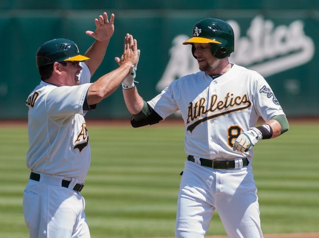 Aug 21, 2013; Oakland, CA, USA; Oakland Athletics third base coach Mike Gallego (2) high fives shortstop Jed Lowrie (8) after hitting a triple during the first inning against the Seattle Mariners at O.Co Coliseum. Mandatory Credit: Ed Szczepanski-USA TODAY Sports