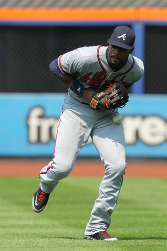 Aug 21, 2013; New York, NY, USA; Atlanta Braves right fielder Jason Heyward (22) can't catch a ball hit by New York Mets center fielder Juan Lagares (not pictured) that resulted in a double during the fifth inning of a game at Citi Field. Mandatory Credit: Brad Penner-USA TODAY Sports