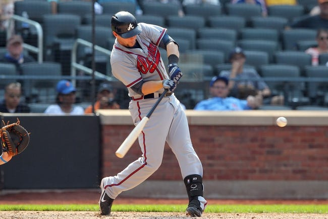 Aug 21, 2013; New York, NY, USA; Atlanta Braves third baseman Chris Johnson (23) hits a three-run home run against the New York Mets during the tenth inning of a game at Citi Field. Mandatory Credit: Brad Penner-USA TODAY Sports
